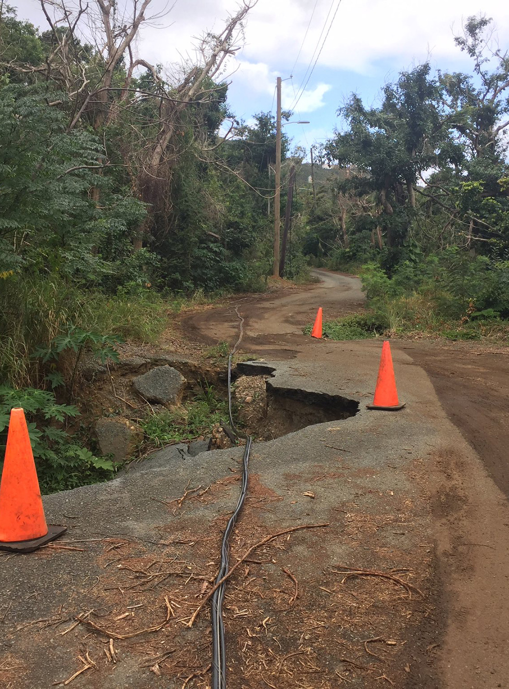 damaged road with cones